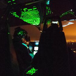 Vol de nuit au dessus de Paris avec un hélicoptère EC-145 et son équipage du Détachement Aérien Gendarmerie de Velizy-Villacoublay.<br /> Octobre 2008 / Région Parisienne (75) / FRANCE<br /> Cliquez ci-dessous pour voir le reportage complet (24 photos) en accès réservé <br /> http://sandrachenugodefroy.photoshelter.com/gallery/2008-10-Vol-de-nuit-en-EC145-Gendarmerie-Complet/G0000FUjp0oafq_8/