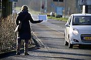 Nederland, Nijmegen, 13-1-2014Marjan Knippenberg lift van huis naar haar werk in de stad.Foto: Flip Franssen/Hollandse Hoogte