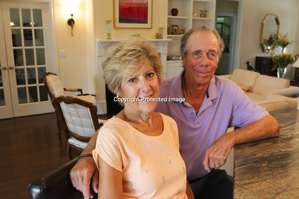 Fred and Jane Appel pose for a portrait at their home in Leland. (Jason A. Frizzelle)