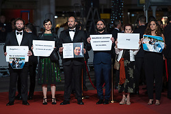 Colombian director Franco Lolli holds up a sign to protest against the assassination of Colombian documentary filmmaker Mauricio Lezama during the Sorry We Missed You Premiere as part of the 72nd Cannes International Film Festival in Cannes, France on May 16, 2019. Photo by Aurore Marechal/ABACAPRESS.COM