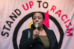 London, UK. 16th March, 2019. Jacqueline McKenzie, immigration lawyer and founder of the Organisation of Migration Advice and Research, addresses thousands of people on the March Against Racism demonstration on UN Anti-Racism Day against a background of increasing far-right activism around the world and a terror attack yesterday on two mosques in New Zealand by a far-right extremist which left 49 people dead and another 48 injured.