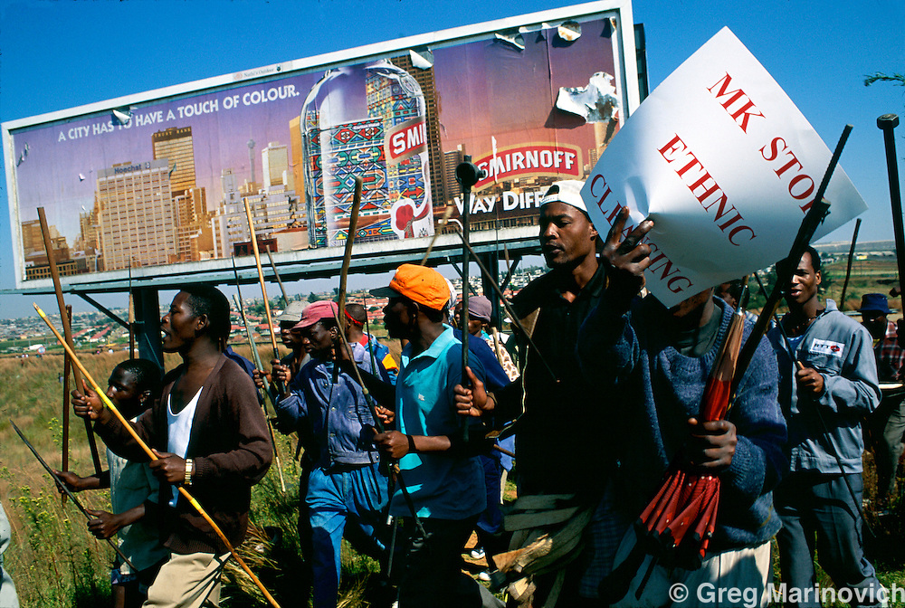 Soweto, Johannesburg. Soweto,  South Africa, Inkatha Freedom Party members carry a sign telling the ANC's armed wing MK to stop ethnic cleansing of Zulus during a march in Soweto, Johannesburg. Soweto,  South Africa