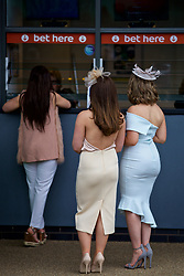 LIVERPOOL, ENGLAND - Thursday, April 6, 2017: Female race goes place a bet at the Tote, during The Opening Day on Day One of the Aintree Grand National Festival 2017 at Aintree Racecourse. (Pic by David Rawcliffe/Propaganda)