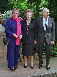 Left to right, MISS CAROL THATCHER, BARONESS THATCHER and SIR DENIS THATCHER, at a party in London on 30th June 1999.MTY 75