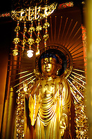 """Buddha reposing in the main altar at the Buddhist Temple of Salinas. """"Hanamatsuri,"""" or flower festival in Japanese, is also known as Buddha's Birthday, and was celebrated on Sunday at the temple."""