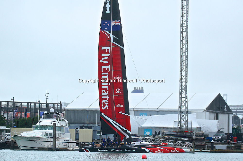 Emirates Team New Zealand's new AC50 is launched for the first time at the Team's base in Auckland. The crew are sitting on the new cycle grinder pedestals.  Tuesday 14 February 2017. Photo: Richard Gladwell - Photosport.nz