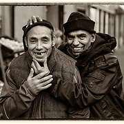 People of Govanhill, Glasgow.  Two friends enjoying some friendly banter on Allison Street.<br /> Picture Robert Perry for The Herald and  Evening Times 5th Dec 2016