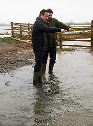 Prime Minister David Cameron.meets farmer  Tim Hook,near Bampton,Oxfordshire,to discuss flooding on farmland . Friday, 14th February 2014. Picture by i-Images