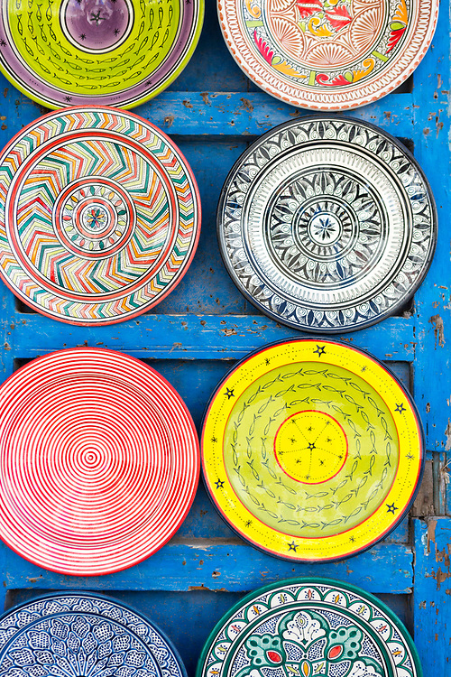 Decorative ceramic plates hang for sale in the Essaouira medina, Southern Morocco