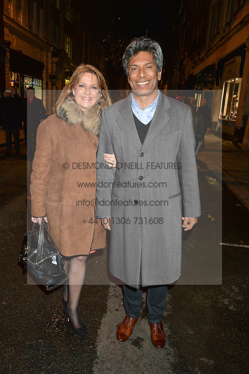 DES GUNEWARDENA Chairman / Ceo Of D&D London and his wife LIZ GUNEWARDENA at the Quintessentially Foundation and The Crown Estate's Fayre of St.James' on 27th November 2014.  The evening started with a christmas concert at St.James's Church, Piccadilly.  Following the concert singer Leona Lewis switched on the Jermyn Street Christmas lights and then guests had a party at the newly refurbished Quaglino's, 16 Bury Street, London