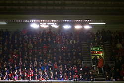 LIVERPOOL, ENGLAND - Thursday, November 26, 2015: Liverpool supporters illuminated by floodlights in the Anfield Road stand during the UEFA Europa League Group Stage Group B match against FC Girondins de Bordeaux at Anfield. (Pic by David Rawcliffe/Propaganda)