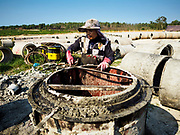 "13 FEBRUARY 2019 - SIHANOUKVILLE, CAMBODIA: A Cambodian worker makes cement sewage lines that will be used in Sihanoukville to improve infrastructure for the Chinese hotels and casinos being built there. There are about 80 Chinese casinos and resort hotels open in Sihanoukville and dozens more under construction. The casinos are changing the city, once a sleepy port on Southeast Asia's ""backpacker trail"" into a booming city. The change is coming with a cost though. Many Cambodian residents of Sihanoukville  have lost their homes to make way for the casinos and the jobs are going to Chinese workers, brought in to build casinos and work in the casinos.      PHOTO BY JACK KURTZ"
