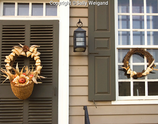 basket with natural materials on door; matching wreath on window; Colonial Williamsburg; Williamsburg; VA; winter