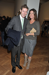 LORD BINGHAM son of the missing 7th Earl of Lucan and CLAIRE MEEHAN at a party to celebrate the launch of the new gallery Pace at 6 Burlington Gardens, London on 3rd October 2012.