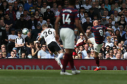 Newcastle United's Jonjo Shelvey (right) scores his side's opening goal during the Premier League match at Craven Cottage, London.