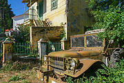 Old dilapidated building in Alexandroupoli, Evros regional unit in East Macedonia and Thrace. Old Military truck on the right