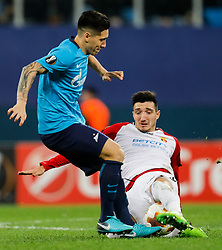 November 23, 2017 - Saint Petersburg, Russia - Matias Kranevitter (L) of FC Zenit Saint Petersburg and Vanja Markovic of FK Vardar vie for the ball during the UEFA Europa League Group L match between FC Zenit St. Petersburg and FK Vardar at Saint Petersburg Stadium on November 23, 2017 in Saint Petersburg, Russia. (Credit Image: © Mike Kireev/NurPhoto via ZUMA Press)