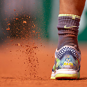 PARIS, FRANCE May 29. A foot of Rafael Nadal of Spain as he knocks the clay off his shoes during his match against Yannick Maden of Germany on Court Suzanne Lenglen in the Men's Singles second round match at the 2019 French Open Tennis Tournament at Roland Garros on May 29th 2019 in Paris, France. (Photo by Tim Clayton/Corbis via Getty Images)