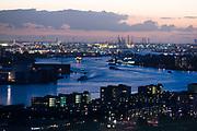 Skyline of Rotterdam Port and Nieuwe Maas at twilight scenery