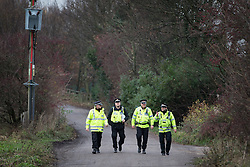 © Licensed to London News Pictures . 27/11/2013 . Manchester , UK . Police patrol the road leading to the site . Energy firm IGas have today (Wednesday 27th November 2013) been receiving drilling equipment in readiness for exploratory drilling at the site . Anti fracking protesters have established a camp at Barton Moss in Greater Manchester alongside an access road leading to an IGas drilling site .  Photo credit : Joel Goodman/LNP