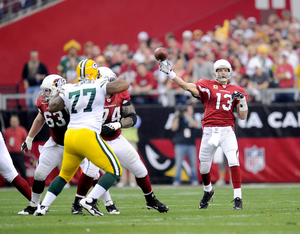 GLENDALE, AZ - JANUARY 10: Kurt Warner #13 of the Arizona Cardinals passes against the Green Bay Packers in the NFC wild-card playoff game at University of Phoenix Stadium on January 10, 2010 in Glendale, Arizona. The Cardinals won the game 51-45 in overtime. (Photo by Rob Tringali/Sportschrome) *** Local Caption *** Kurt Warner