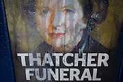 The face of ex-British Prime Minister Margaret Thatcher printed on a newspaper souvenir issue is rain streaked the day after her ceremonial funeral was held in central London.