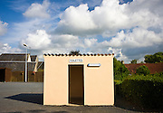 Toilets and telephone cabin hut utilities in the town of Houesville, Normandy, France Toilettes cabine telephonique