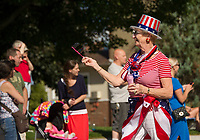 "A festive ""red, white and blue"" marcher in Laconia's 4th of July parade on Tuesday.  (Karen Bobotas/for the Laconia Daily Sun)"