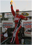 HAMPTON, GA: Carl Edwards celebrates in victory lane   after winning the Pep Boys Auto 500 at Atlanta Motor Speedway on Sunday10/26/08. © 2008 Johnny Crawford