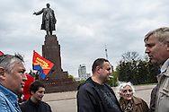 KHARKIV, UKRAINE - APRIL 22: A small group of pro-Russian, pro-Communist, and other individuals gather below a statue of Russian revolutionary leader Vladimir Lenin on Freedom Square on what would have been his 144th birthday on April 22, 2014 in Kharkiv, Ukraine. Pro-Russian activists have been occupying government buildings and demanding greater autonomy in many Eastern Ukrainian cities in recent weeks. (Photo by Brendan Hoffman/Getty Images) *** Local Caption ***