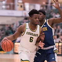 3rd year forward Shaquille Harris (6) of the Regina Cougars in action during the Men's Basketball home game on January  19 at Centre for Kinesiology, Health and Sport. Credit: Arthur Ward/Arthur Images