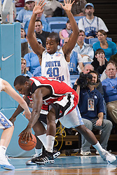 28 December 2006: North Carolina Tarheel forward (40) Mike Copeland defends Rutgers forward (13) Ollie Bailey during a 87-48 Rutgers Scarlet Knights loss to the North Carolina Tarheels, in the Dean Smith Center in Chapel Hill, NC.<br />