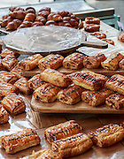 A selection of pastries laid out in a Kuala Lumpur cafe.