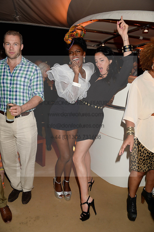 The Johnnie Walker Gold Label Reserve Party aboard John Walker & Sons Voyager, St.Georges Stairs Tier, Butler's Wharf Pier, London, UK on 17th July 2013.<br /> Picture Shows:-Shingai Shoniwa & Amy Molyneaux