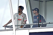 Alastair Cook of Essex and Essex captain Ryan ten Doeschate look out from the team balcony during the delay the start of play after a heavy rain shower this morning ahead of the Specsavers County Champ Div 1 match between Somerset County Cricket Club and Essex County Cricket Club at the Cooper Associates County Ground, Taunton, United Kingdom on 26 September 2019.