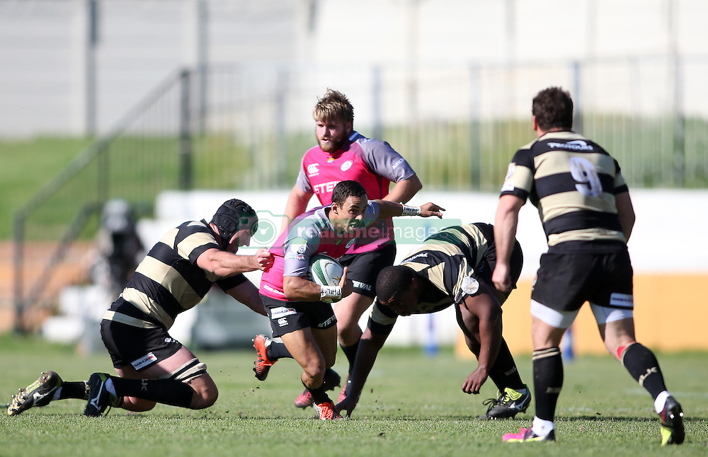Jean-Paul Lewis of the Pumas attempts to slip the tackle during the Currie Cup premier division match between the Boland Cavaliers and The Pumas held at Boland Stadium, Wellington, South Africa on the 2nd September 2016<br /> <br /> Photo by:   Shaun Roy/ Real Time Images