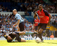 Photo. Jed Wee, Digitalsport<br /> Lucas Radebe Testimonial, Leeds United XI v International XI, 02/05/2005.<br /> Lucas Radebe is allowed to scythe through the defence but overruns the ball after going past goalkeeper Neil Sullivan