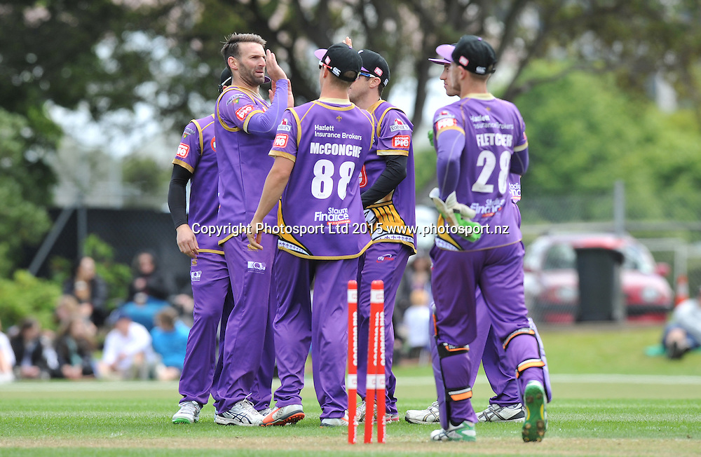 Canterbury Kings Andrew Eliis and team mates celebrate the wicket of Otago Volts Brad Wilson in the Georgie Pie Super Smash Twenty20 cricket match between the Otago Volts v Canterbury Kings held at the University Oval, Dunedin. 29 November 2015.