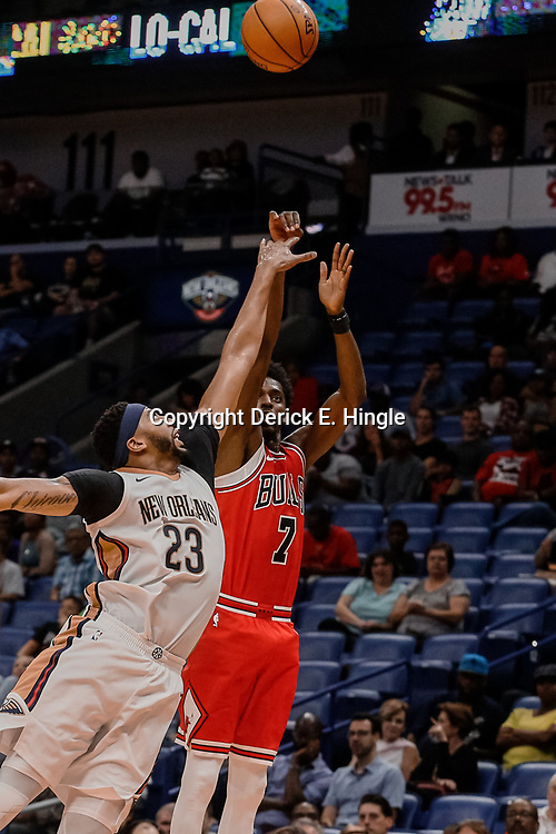 Oct 3, 2017; New Orleans, LA, USA; Chicago Bulls guard Justin Holiday (7) shoots over New Orleans Pelicans forward Anthony Davis (23) during the second quarter of a NBA preseason game at the Smoothie King Center. Mandatory Credit: Derick E. Hingle-USA TODAY Sports