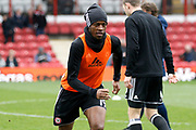 Brentford Midfielder Romaine Sawyers (19) warms up before kick off during the EFL Sky Bet Championship match between Brentford and Ipswich Town at Griffin Park, London, England on 7 April 2018. Picture by Andy Walter.