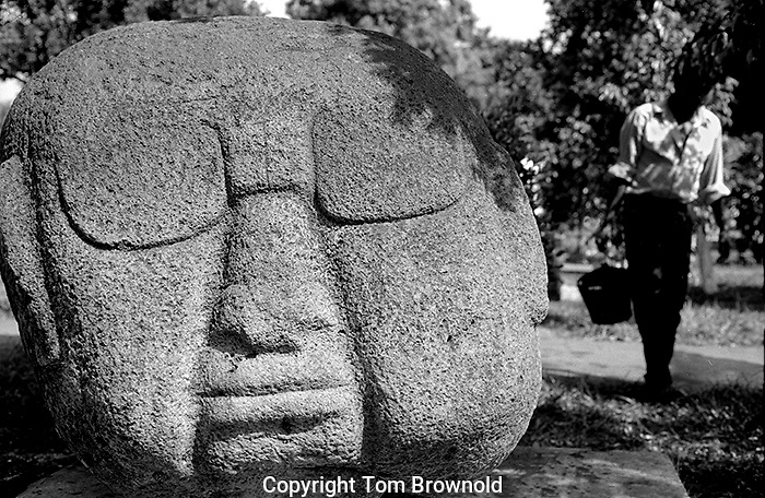 Olmec head found in a farmers field currently situated in the town square of La Democracia, Guatemala