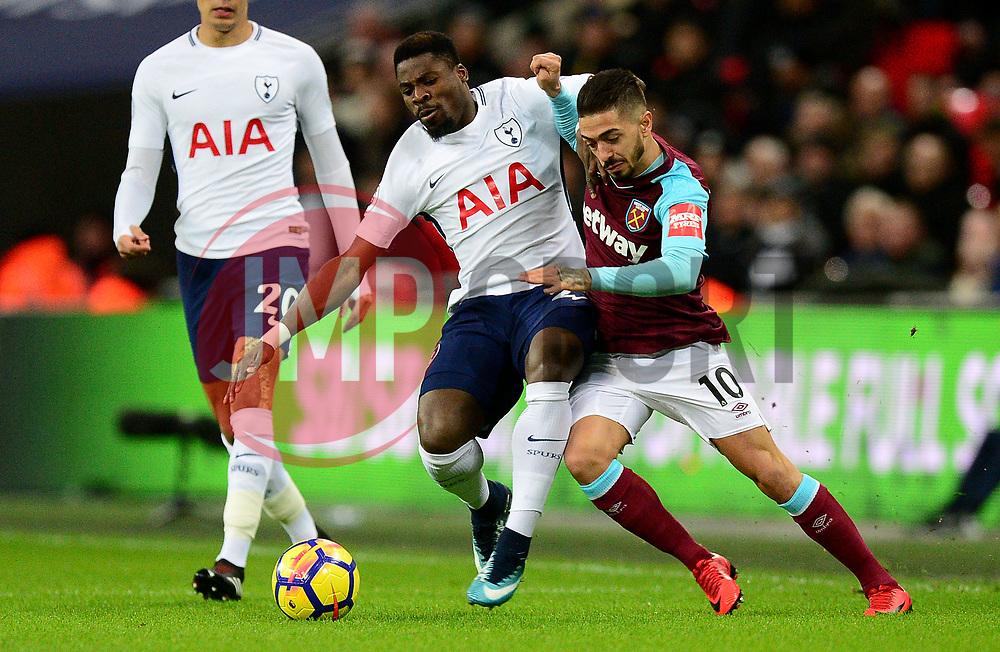 Serge Aurier of Tottenham Hotspur battles for the ball with Manuel Lanzini of West Ham United - Mandatory by-line: Alex James/JMP - 04/01/2018 - FOOTBALL - Wembley Stadium - London, England - Tottenham Hotspur v West Ham United - Premier League