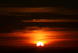 © Licensed to London News Pictures. 11/01/2014. Glastonbury, UK Sunset over Glastonbury Tor , Somerset today 11th January 2014. Photo credit : Jason Bryant/LNP