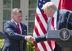 April 5, 2017 - Washington, District of Columbia, U.S. - United States President DONALD TRUMP, right, and King ABDULLAH II of Jordan, left, shake hands as they conduct a joint press conference in the Rose Garden of the White House. (Credit Image: © Ron Sachs/CNP via ZUMA Wire)
