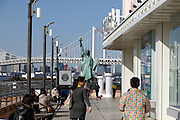 a replica Statue of Liberty with the Rainbow Bridge and Tokyo Tower Japan