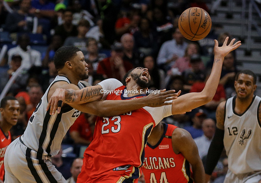 Apr 11, 2018; New Orleans, LA, USA; San Antonio Spurs forward Rudy Gay (22) fouls New Orleans Pelicans forward Anthony Davis (23) during the first quarter at the Smoothie King Center. Mandatory Credit: Derick E. Hingle-USA TODAY Sports
