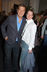 MARIO TESTINO and LADY HELEN TAYLOR at the opening of the second annual Photo-London exhibition at The Royal Academy, Burlington Gardens, London on 18th May 2005.<br />