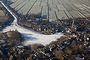 Nederland, Noord-Holland, Broek in Waterland, 10-01-2009; klassiek winters tafereel, naar Breugel; schaatsers op het Havenrak, rond het ijs houten huizen en onder in beeld de Sint-Nicolaaskerk, links een wak voor de vogels; classic winter scene with skaters on frozen pond in old duth village;.Brueghel, Bruegel of Breughel; schaats, schaatsen, ijs, ijspret, pret, ijsbaan, natuurijs, schaatsen rijden, winter, koud, vriezen, min nul, beneden nul, koud, celsius, skating, ice skating, ice, fun, skating rink, natural, skate, snow, cold, freezing, minus zero, below zero, cold, winterlandscahp, winter landscape, tocht, toertocht, koek en zopie . .luchtfoto (toeslag); aerial photo (additional fee required); .foto Siebe Swart / photo Siebe Swart