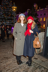 Left to right, LARA HUGHES-YOUNG and ASTRID HARBORD at the launch of Skate at Somerset House in association with Fortnum & Mason held at Somerset House, The Strand, London on 17th November 2015.