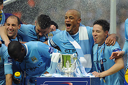 Manchester City celebrate their win against Sunderland in the capital one cup final - Photo mandatory by-line: Dougie Allward/JMP - Tel: Mobile: 07966 386802 02/03/2014 - SPORT - FOOTBALL - London - Wembley Stadium - Manchester City v Sunderland - Capital One Cup Final